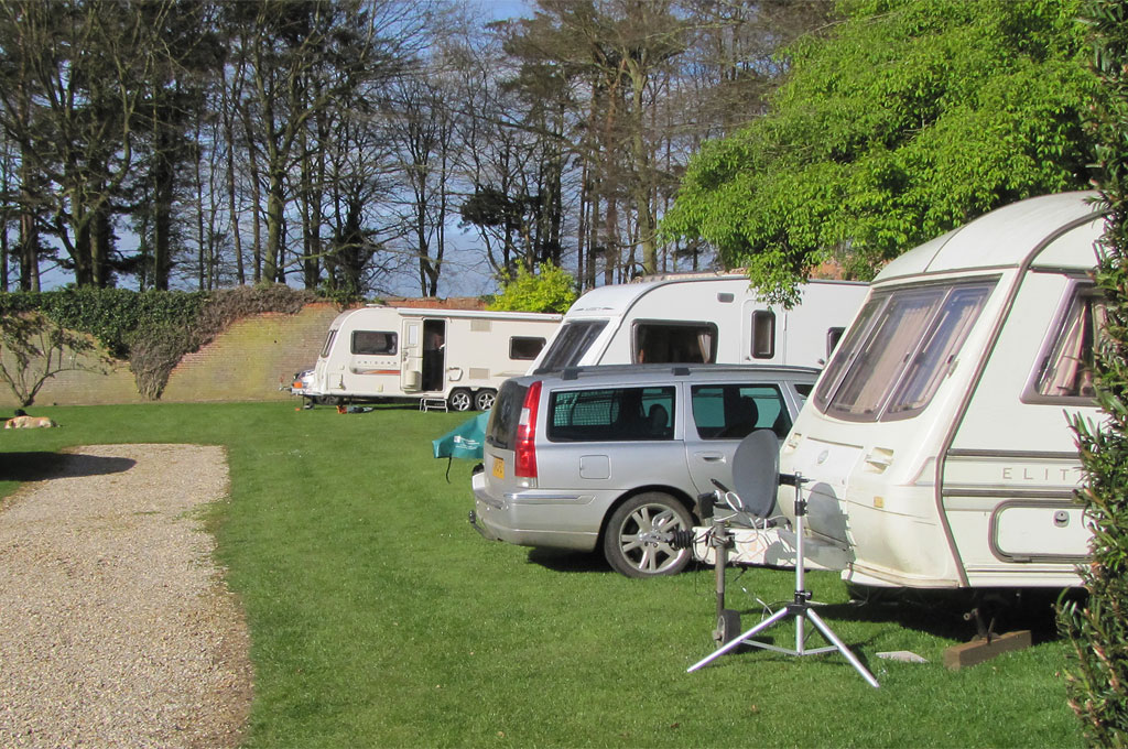 Orange caravan at Garden Caravan Site, Barmer, North-west Norfolk